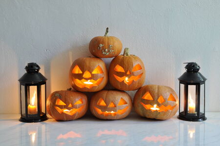 Halloween still life with pumpkins, candles and decorative lantern