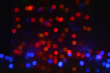 Celebration bokeh flares background with shining christmas garland lights
