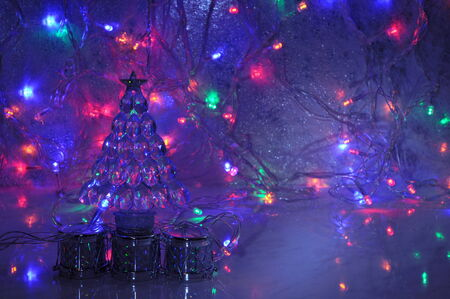 Christmas background with new year tree decoration and shining garland lights.