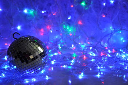 disco lights: Disco christmas background with mirror ball and shining new year garland lights.