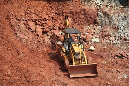 Bulldozer at construction site working in gravel pit Stock Photo