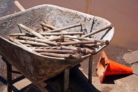 wheel barrel: Construction Wheel Barrel Full of Steel Pins