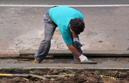 curb: Construction Worker Cementing Curb