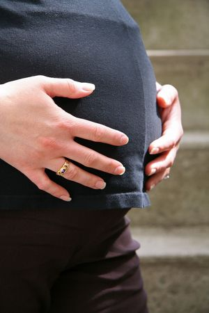 Expecting Mother Holding her Stomach photo