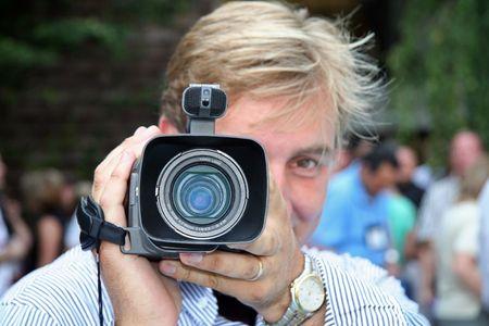 Camera Man Holding Digital Video Recorder