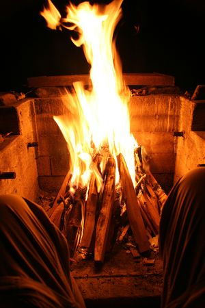 Camper Resting by Fire Pit Stock Photo - 651530