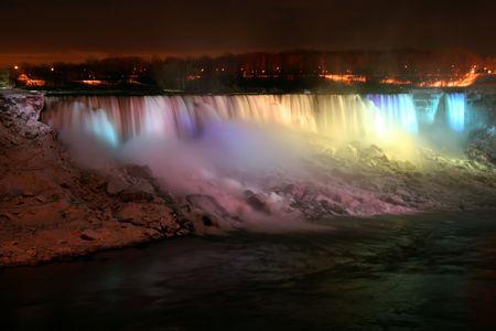 Niagara Falls at Night with Lights - American and Veil Falls Фото со стока