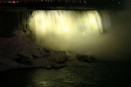 Niagara Horse Shoe Falls at Night with Yellow Lights photo