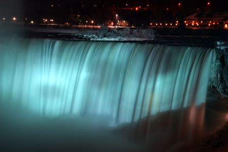 Niagara Horse Shoe Falls at Night with Blue Lights Фото со стока