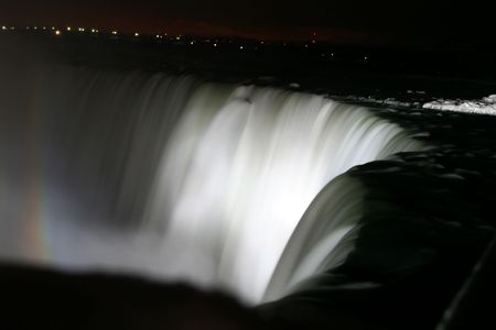 Niagara Horse Shoe Falls at Night with Rainbow