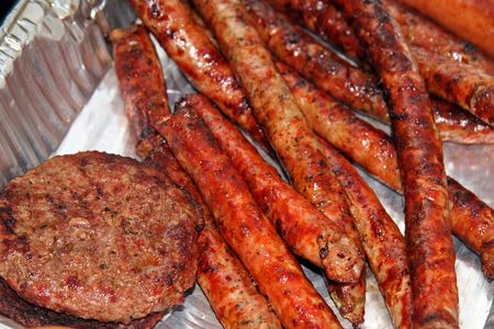 Hamburgers and Sausages after a BBQ Roast Stock Photo - 651352