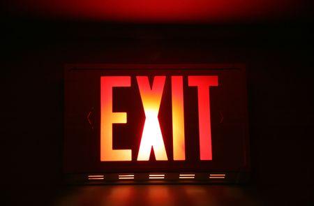 get out: Emergency Exit Sign Hanging in Hallway Door Stock Photo