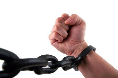Mannelijke Hand met Fist kettingoperatie aan verbonden Manchetten Stockfoto
