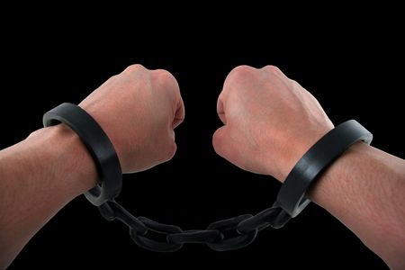 Male Hand with Hands Chained to Linked Cuffs photo