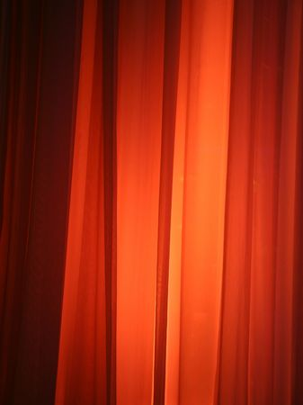 Spot Light Against Curtain Red Background Design