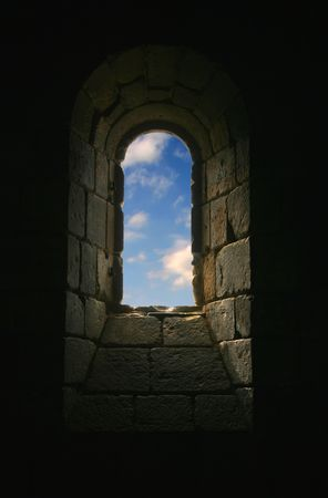 Church Keyhole with Blue Sky and Clouds in Window Stock Photo
