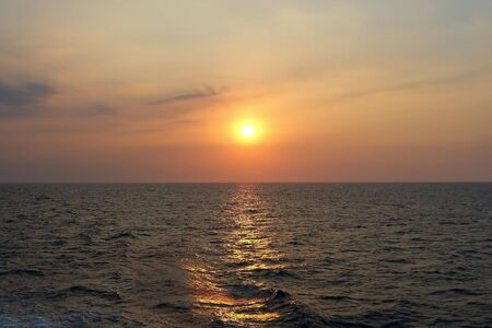 Sunset at Sea with Orange and Yellow Sky Stok Fotoğraf