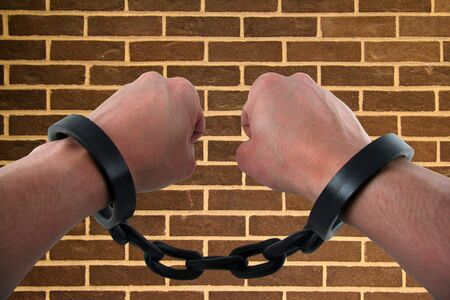Male Hand with Hands Chained to Linked Cuffs Stock Photo - 754638