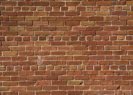 Red Brick Wall Pattern Background on Building photo