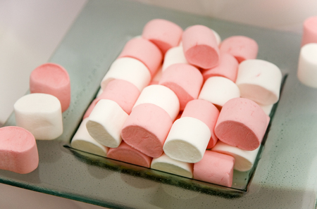 Pink and White Marshmallow Treats on a Plate photo