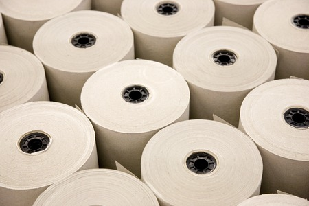tons: Industrial White Paper Rolls in a Row Stock Photo