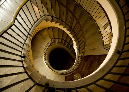 Luxurious Spiral Staircase with Stone Steps Stock Photo
