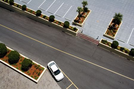 Aerial View of Parking Lot with Car in Space Stock Photo