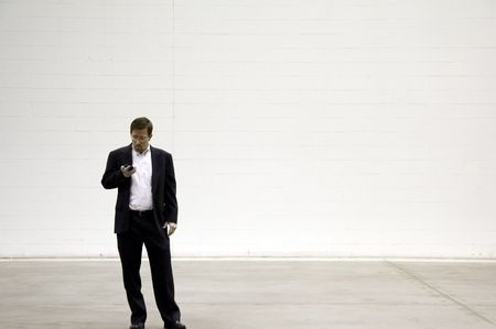Business Man on Phone against White Background