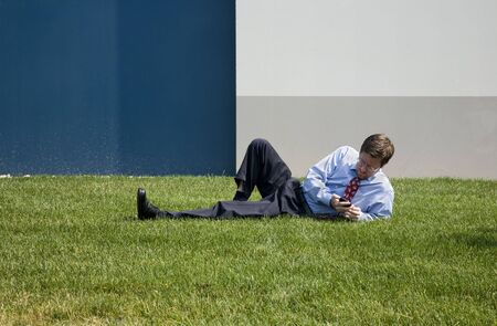 Business Man on Phone while Laying Down