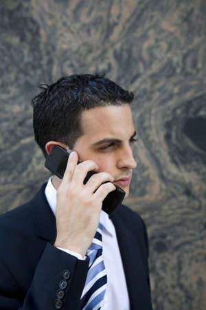 early twenties: Attractive Young Executive on Cell Phone - Early Twenties