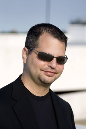 blazer: Casual Man with Sunglasses and Black Blazer Suit Stock Photo