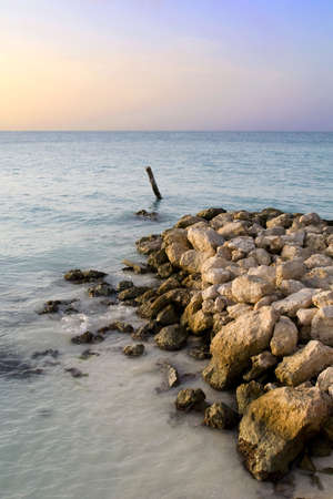 Sunset on a Mexican Coastline with a Rocky Shore photo