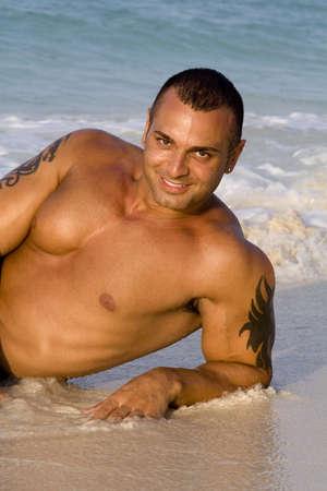 beach hunk: Tanned Male Model Lying Down on Beach