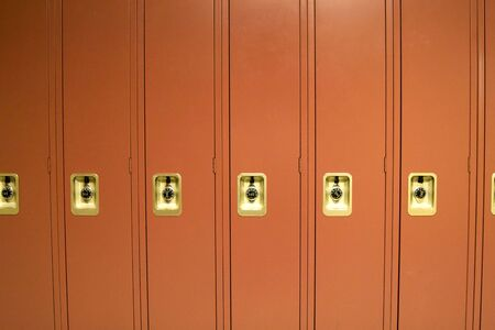 Red School Lockers in High School Hallway Stock Photo