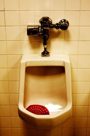 defecation: Dirty Urinal in Mens Room with Brown Stains