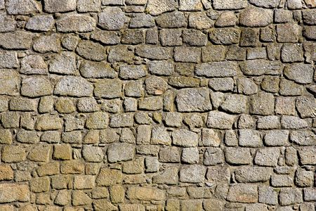 stone age: Weathered Stonewall Background from a Castle Wall Stock Photo