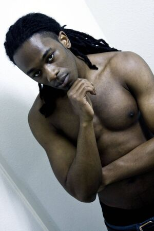 dreadlock: Young Urban African American Male Shirtless with Serious Expression