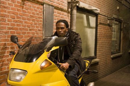 Young Urban African American Male on Motorcycle with Serious Look Stock Photo