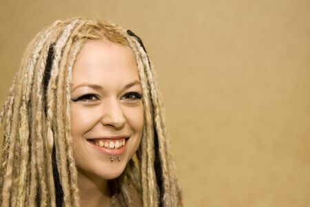 dread: Smiling Woman with Face Piercings and Dread Lock Hair