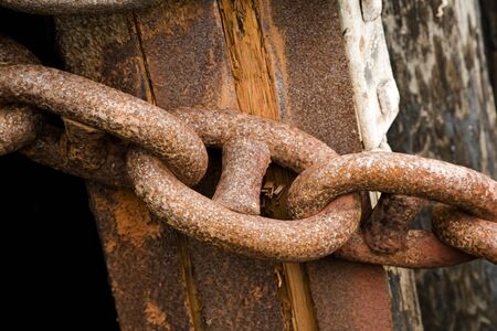 Secure Rusty Chains on a Ship Dock Stock Photo - 4153068