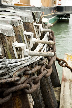 Rusty Chains Secured to Wooden Ship Dock Stock Photo - 4153075