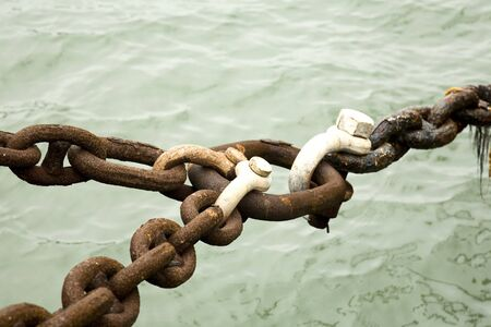 Rusty Chains Locked Together at a Ship Dock Stock Photo - 4153064