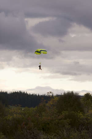 Tandem Paragliders Decending onto Ground