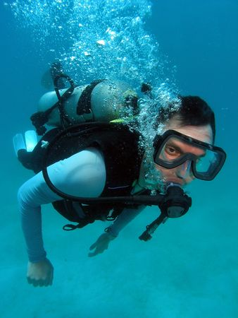 Man Scuba Diving in Great Barrier Reef Stock Photo - 4949225