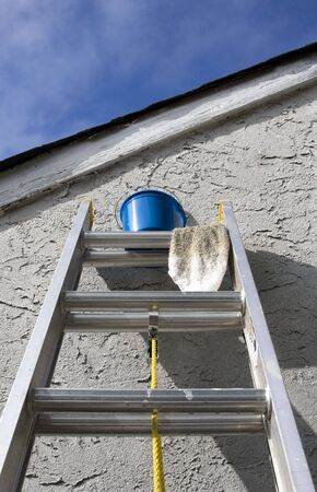 Painting Materials on Ladder Against Home Wall