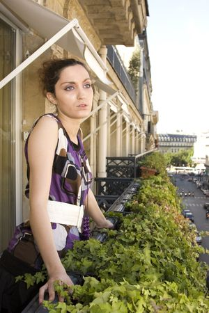 Young Woman on Balcony in Paris, France