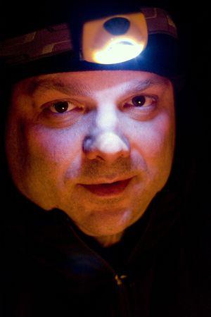 Adult Male Illuminated with Headlight in the Dark