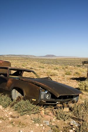 Old Abandoned Junk Car in Desert photo