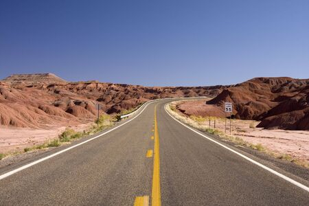 Empty Desert Highway in Utah with Mountains Stock Photo - 5127827