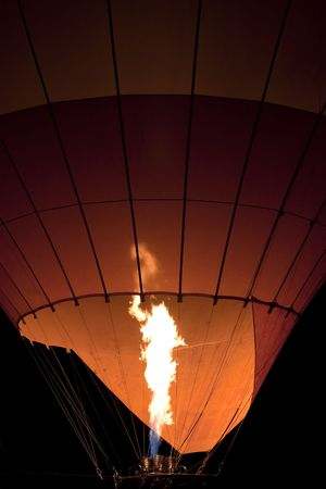 Inflating Orange Hot Air Balloon at Night with Flame